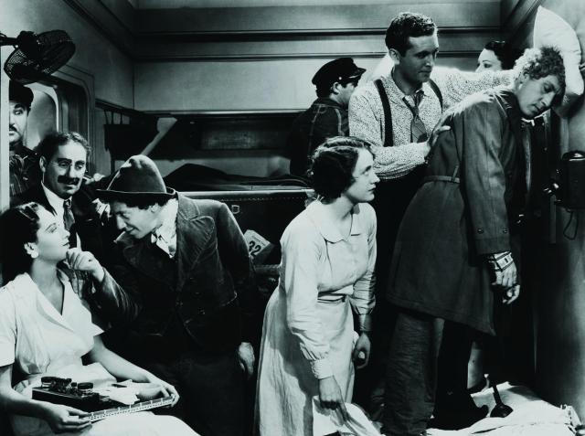 still-of-groucho-marx,-edna-bennett,-allan-jones,-chico-marx,-harpo-marx-and-inez-palange-in-a-night-at-the-opera-(1935)-large-picture