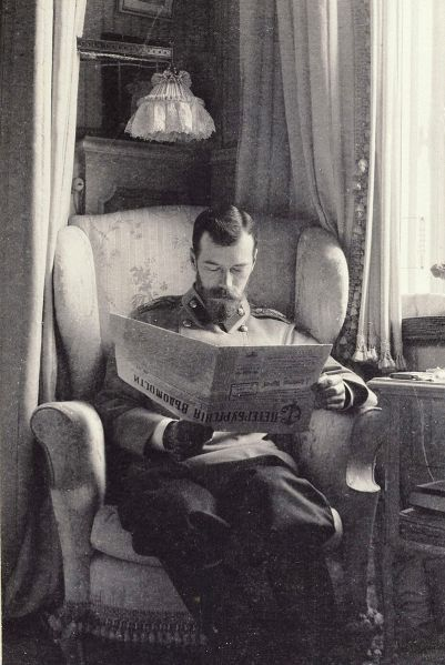 Nicholas_II_of_Russia_reading_the_St_Petersburg_News