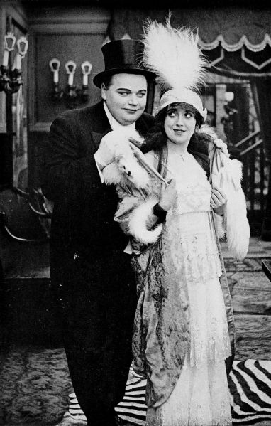 roscoe_arbuckle_and_mabel_normand_-_the_movies_come_from_america