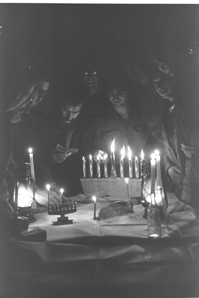 flickr_-_government_press_office_gpo_-_soldiers_lighting_the_hanuka_candles_during_yom_kippur_war