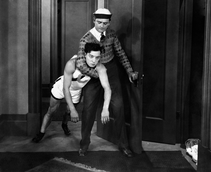 1927: An actor carries Buster Keaton, in the role of Ronald, in the 1927 movie College.